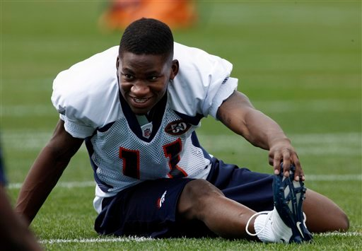 Denver Broncos rookie wide receiver Kenny McKinley stretching before drills at the team's training camp in Englewood, Colo.