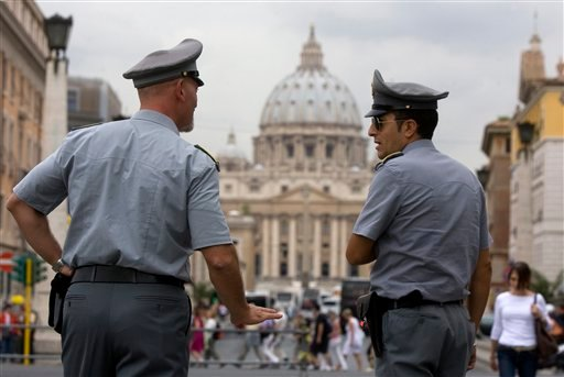 Italian financial Police officers talk to each other in front of St. Peter's square at the Vatican, Tuesday, Sept. 21, 2010.