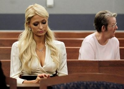 Paris Hilton waits for her hearing to start in Clark county court to plead guilty to reduced charges in her August cocaine arrest Monday, Sept. 20, 2010, in Las Vegas.