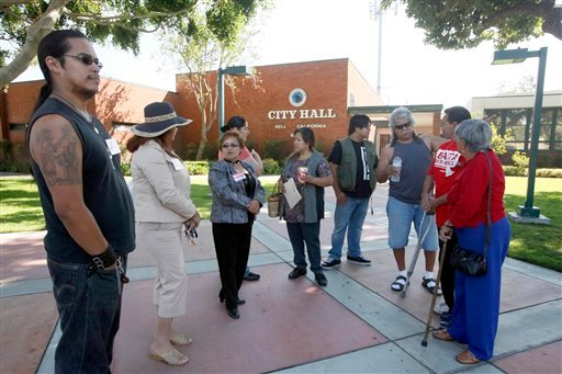Residents of Bell, Calif., wait outside City Hall Wednesday Sept. 15, 2010 in Bell.