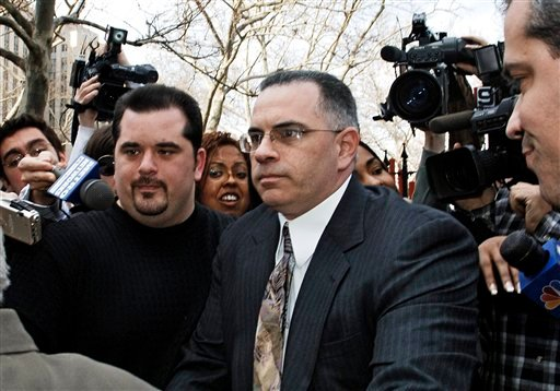 "FILE - In this March 10, 2006 file photo, John ""Junior"" Gotti exits Manhattan federal court with his brother Peter, left, by his side, in New York."