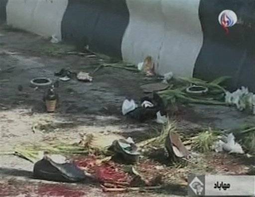 Bloodstained debris litter the street after a bomb blast in Mahabad Iran in this image taken from TV Wednesday Sept 22, 2010. (AP Photo/Al Alam, via APTN)