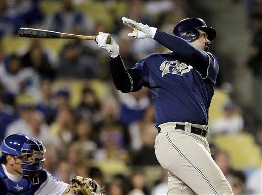 San Diego Padres' Adrian Gonzalez follows through on a double during the third inning of a baseball game with the Los Angeles Dodgers in Los Angeles, Tuesday, Sept. 21, 2010. (AP Photo/Jae C. Hong)