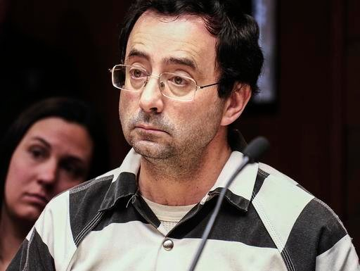 Dr. Larry Nassar listens to testimony of a witness during a preliminary hearing, in Lansing, Mich. (Robert Killips/Lansing State Journal via AP, File)