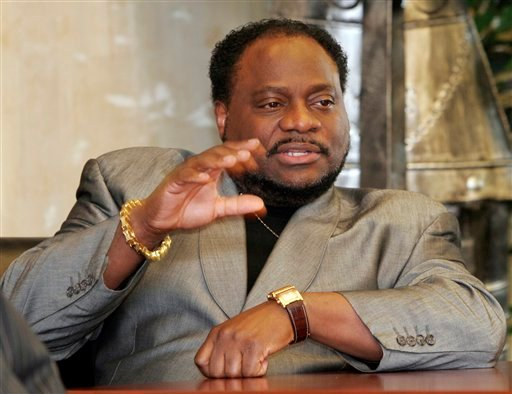 In this Jan. 18 2007 file photo, Bishop Eddie Long, of the New Birth Missionary Baptist Church, in Lithonia, Ga. gestures during an interview in Lithonia.