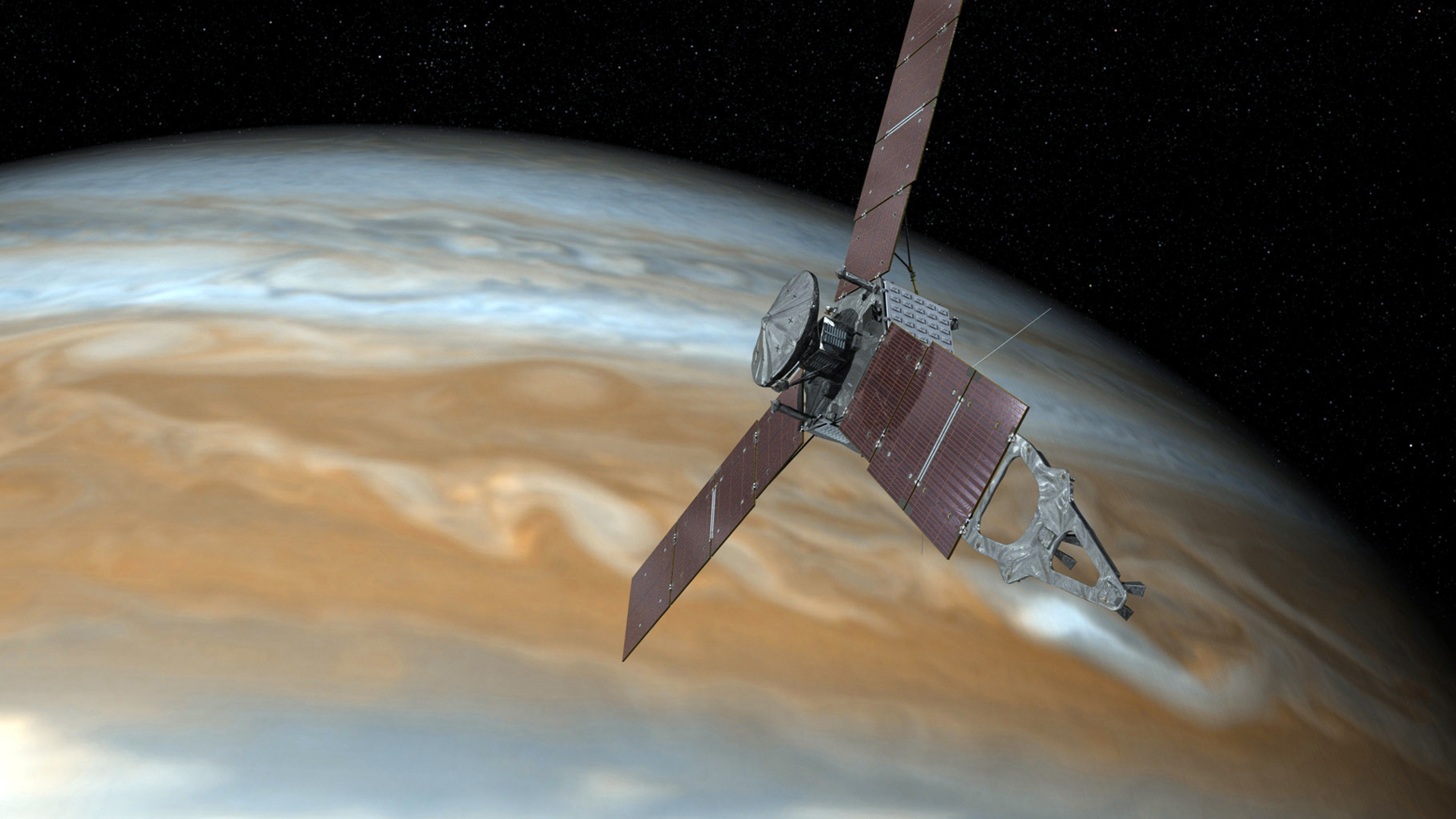 An undated image shows shows an artist's rendering of NASA's Juno spacecraft making a close pass over Jupiter. (NASA via AP)