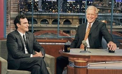 In this photo released by CBS, actor Joaquin Phoenix, left, joins host David Letterman on the set of the 'Late Show with David Letterman,' Wednesday, Sept. 22, 2010, in New York.
