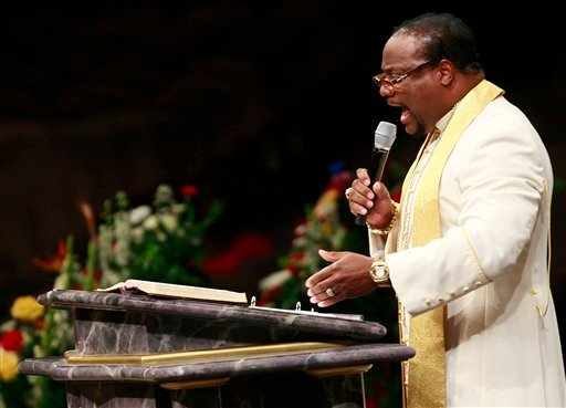 In this Monday, Aug. 3, 2009 file photo, Bishop Eddie Long speaks during a funeral service at New Birth Missionary Baptist Church in Lithonia, Ga. Long. (AP Photo/John Bazemore, File)
