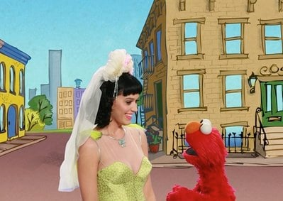 In this publicity image released by Sesame Workshop, singer Katy Perry, left, is shown with Elmo performing in a music video called 'Hot and Cold' about opposites on 'Sesame Street.'