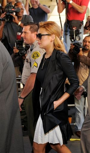 Lindsay Lohan arrives for a hearing at the Beverly Hills Courthouse in Beverly Hills, Calif., Friday, Sept. 24, 2010. (AP Photo/Chris Pizzello)
