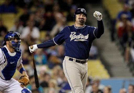San Diego Padres' Adrian Gonzalez swings and misses the ball during the fourth inning of a baseball game with the Los Angeles Dodgers in Los Angeles, Thursday, Sept. 23, 2010. (AP Photo/Jae C. Hong)