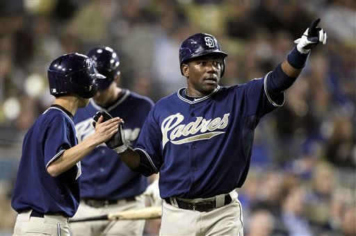 San Diego Padres' Miguel Tejada  reacts after scoring on Ryan Ludwick's two-run single during the third inning of a baseball game against the Los Angeles Dodgers in Los Angeles, Tuesday, Sept. 21, 2010. (AP Photo/Jae C. Hong)