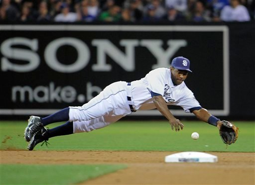 San Diego Padres shortstop Miguel Tejada makes a diving stop on a ground ball hit by Los Angeles Dodgers Brad Ausmus during the third inning of a baseball game Monday, Sept. 6, 2010 in San Diego. Tejada got the out at first base. (AP Photo/Denis Poroy)