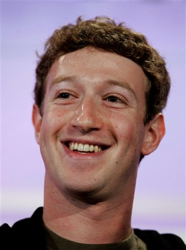 In this Wednesday, Oct. 17, 2007 photograph, Facebook founder Mark Zuckerberg smiles during a talk at Web 2.0 conference in San Francisco.