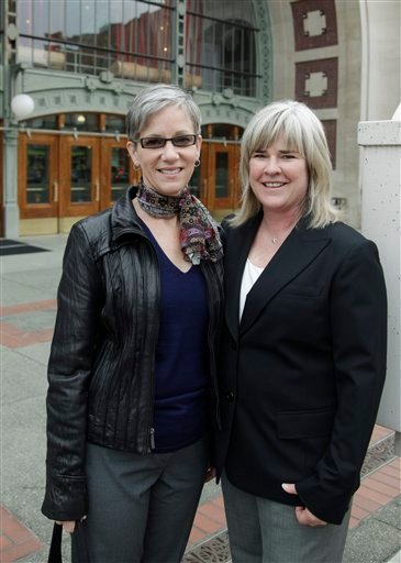 Margaret Witt and her partner, Laurie McChesney, pose for a photo Wednesday, Sept. 15, 2010, outside the federal courthouse in Tacoma, Wash.