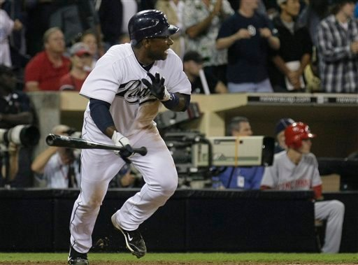 San Diego Padres' Miguel Tejada hits a single to drive in two runs against the Cincinnati Reds in the seventh inning during their baseball game Friday, Sept. 24, 2010, in San Diego. (AP Photo/ Gregory Bull)