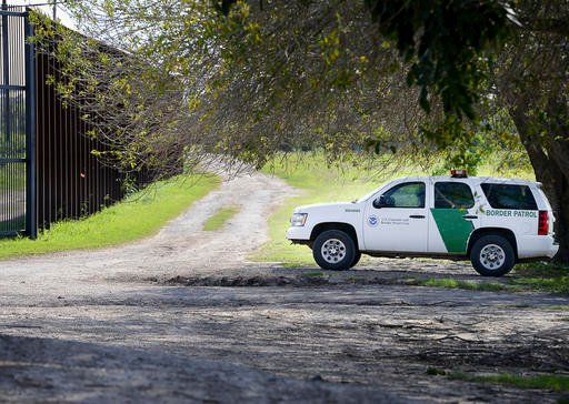 A U.S. Border Patrol agent guards a fence gate along the U.S.-Mexico border, Thursday, Feb. 16, 2017, in Brownsville, Texas.