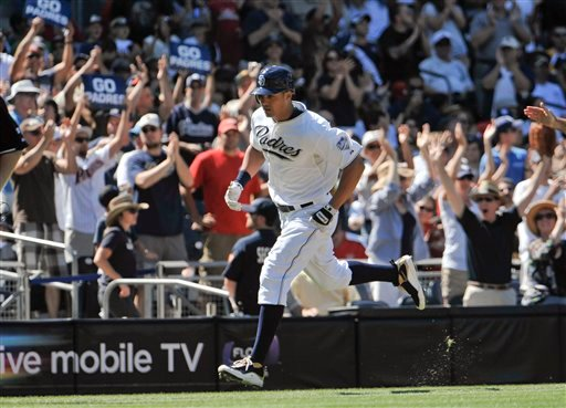 San Diego Padres' Will Venable rounds the bases after hitting a solo home during the third inning of a baseball game against the Cincinnati Reds, Saturday, Sept. 25, 2010, in San Diego. AP Photo/Denis Poroy)