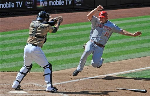 Cincinnati Reds' Chris Heisey tries to score past the tag of San Diego Padres catcher Yorvit Torrealba during the fourth inning of a baseball game Sunday, Sept. 26, 2010 in San Diego. Heisey was out on the play. (AP Photo/Denis Poroy)