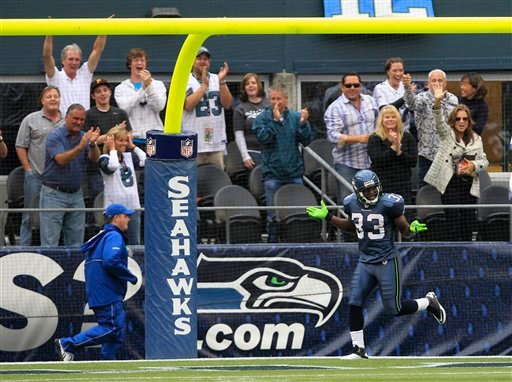 Seattle Seahawks' Leon Washington reacts after making a 99-yard kickoff return for a touchdown against the San Diego Chargers in the second half of an NFL football game, Sunday, Sept. 26, 2010, in Seattle. The Seahawks beat the Chargers 27-20. (AP Photo/)