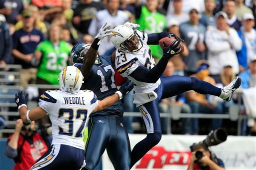 San Diego Chargers' Quentin Jammer intercepts a pass intended for Seattle Seahawks' Mike Williams (17) as Chargers' Eric Weddle looks on in the first half of an NFL football game, Sunday, Sept. 26, 2010, in Seattle. (AP Photo/Elaine Thompson)