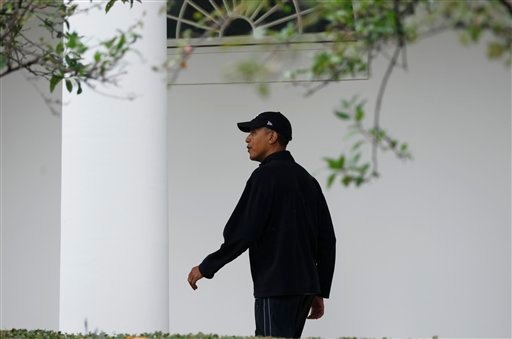 President Barack Obama walks down the West Wing colonnade of the White House in Washington after he returns from a private game of basketball Sunday, Sept. 26, 2010. (AP Photo/Charles Dharapak)