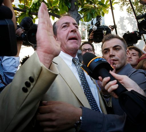 Michael Lohan, father of Lindsay Lohan, is interviewed as he leaves the Beverly Hills Courthouse following a hearing for his daughter in Beverly Hills, Calif., Friday, Sept. 24, 2010. (AP Photo/Nick Ut)