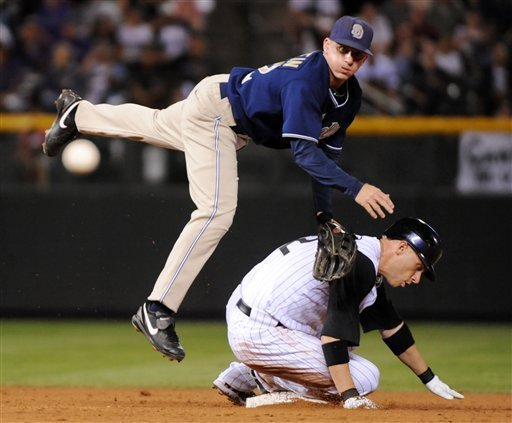 San Diego Padres second baseman David Eckstein  throws to first after forcing out Colorado Rockies' Clint Barmes during the eighth inning of a baseball game in Denver, Monday, Sept. 13, 2010. Jonathan Herrera was safe at first. (AP Photo/Jack Dempsey)