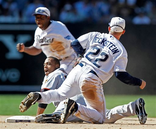 San Diego Padres second baseman David Eckstein, right, and shortstop Miguel Tejada celebrates after San Francisco Giants' Darren Ford was forced out after Buster Posey hit into a double play to end the baseball game in San Diego. (AP Photo/Chris Carlson