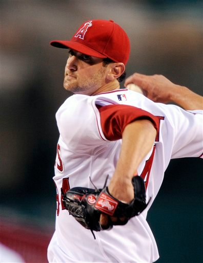 In this April 8, 2009, file photo, Los Angeles Angels pitcher Nick Adenhart throws during a baseball against the Oakland Athletics in Anaheim, Calif.