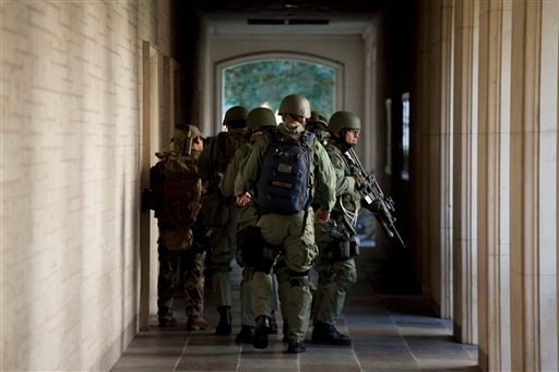 Soldiers prepare to enter Calhoun Hall at the University of Texas in Austin, Texas on Tuesday Sept. 28, 2010. A gunman opened fire Tuesday inside the Perry-Castaneda Library then fatally shot himself. (AP Photo/The Daily Texan, Tamir Kalifa)