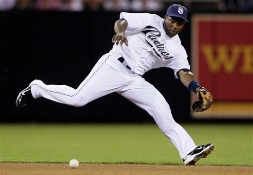 San Diego Padres shortstop Miguel Tejada chases down a grounder by Chicago Cubs' Starlin Castro in the fifth inning during a baseball game Tuesday, Sept. 28, 2010, in San Diego. (AP Photo/ Gregory Bull)