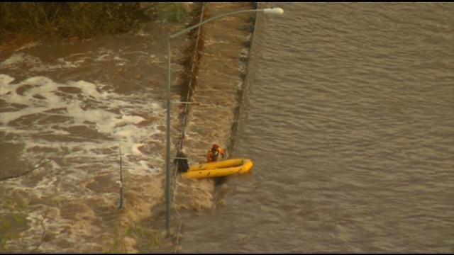 Swift water rescue in Mission Valley, after a man was stranded in the San Diego River, holding on to the railing until emergency crews arrived. (Tuesday, February 28, 2017)
