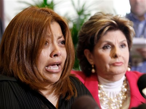 Nicky Diaz, left, former housekeeper for California GOP gubernatorial candidate Meg Whitman, talks to reporters with attorney Gloria Allred in Los Angeles Wednesday, Sept. 29, 2010.