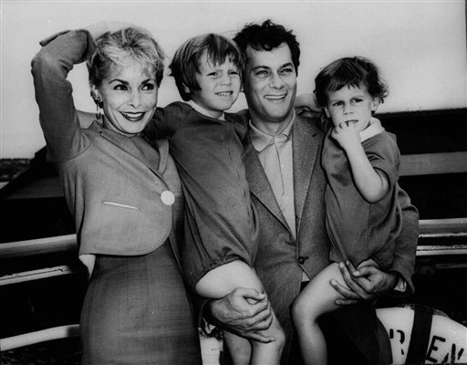 "FILE - Tony Curtis and Janet Leigh pose with their children, Kelly 5, and Jamie, 2 1/2 in this Sept. 19,1961 file photo prior to their departure on the SS Argentina for the Argentine where Curtis was to do location filming for the movie ""Taras Bulba."""