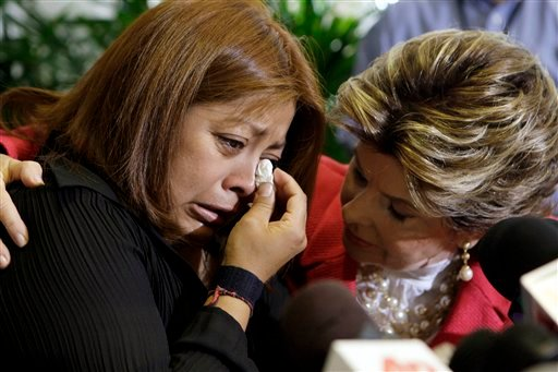 Nicky Diaz, left, former housekeeper for California GOP gubernatorial candidate Meg Whitman, weeps as she talks to reporters with attorney Gloria Allred in Los Angeles Sept. 29, 2010. (AP Photo/Reed Saxon)