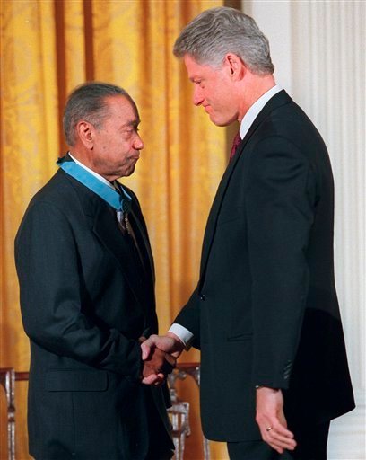 President Clinton shakes hands with Vernon Baker after presenting him with a Medal of Honor, Monday Jan. 13, 1997 at the White House.
