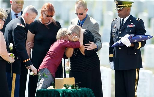 Heidemaria Baker, widow of Medal of Honor recipient Vernon J. Baker, grieves over his remains during his burial at Arlington National Cemetery in Arlington, Va., Friday, Sept. 24, 2010.