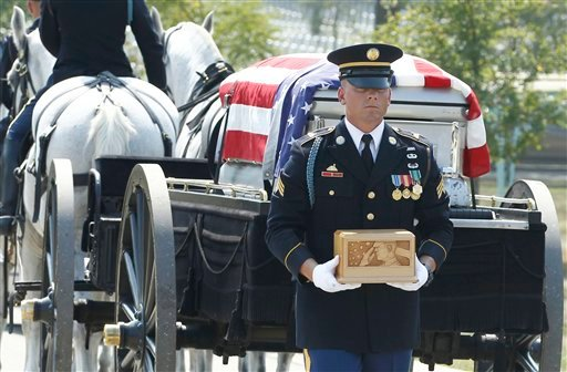 A member of the honor guard carries the remains of Medal of Honor recipient Vernon J. Baker, during his burial at Arlington National Cemetery