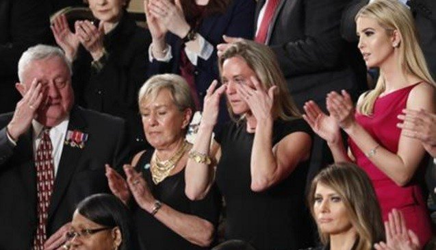 "Carryn Owens, widow of widow of Chief Special Warfare Operator William ""Ryan"" Owens, wipes her eyes on Capitol Hill in Washington, Tuesday, Feb. 28, 2017."