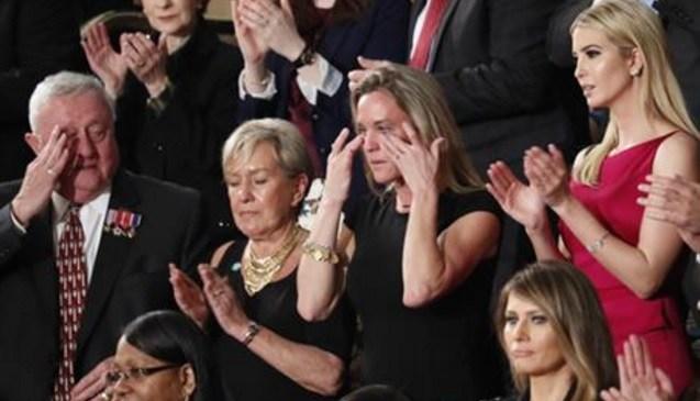 "Carryn Owens, widow of widow of Chief Special Warfare Operator William ""Ryan"" Owens, wipes her eyes on Capitol Hill in Washington, Tuesday, Feb. 28, 2017."