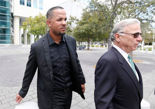 Chicago White Sox first baseman Jose Abreu, left, and attorney Roberto Martinez, right, leave federal court during a break, Wednesday, March 1, 2017 in Miami.