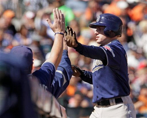 San Diego Padres' David Eckstein is greeted near the dugout after scoring the Padres' second run in the first inning of their baseball game against the San Francisco Giants in San Francisco, Saturday, Oct. 2, 2010. (AP Photo/Eric Risberg)