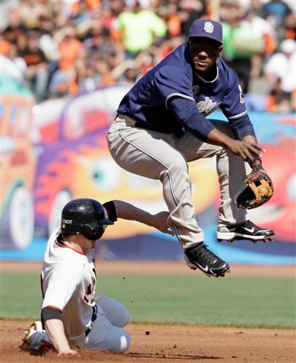 San Francisco Giants' Mike Fontenot, is forced out at second base as San Diego Padres shortstop Miguel Tejada, right, turns a double play during the first inning of their baseball game in San Francisco, Saturday, Oct. 2, 2010. (AP Photo/Eric Risberg)