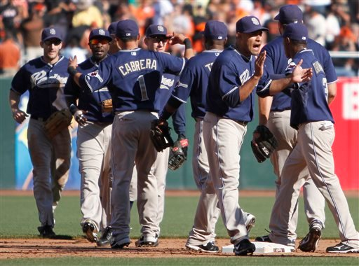 The San Diego Padres celebrate their 4-2 defeat of the San Francisco Giants at the end of a baseball game Saturday, Oct. 2, 2010, in San Francisco. (AP Photo/Ben Margot)