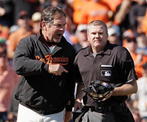 San Francisco Giants manager Bruce Bochy, left, argues with home plate umpire Mike Everitt, right, after the Giants' Buster Posey was called out on strikes during the sixth inning of their baseball game against the San Diego Padres. (AP)