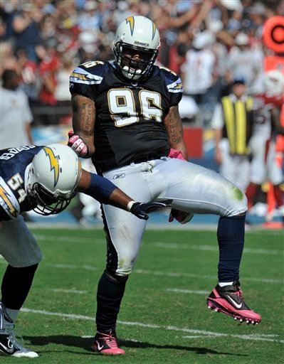 San Diego Chargers  defensive end Travis Johnson celebrates a sack against the Arizona Cardinals during the first half of an NFL football game Sunday, Oct. 3, 2010, in San Diego. (AP Photo/Denis Poroy)