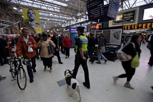 A police officer with a dog, patrols a central London train station, Monday Oct. 4, 2010. (AP Photo/Lefteris Pitarakis)