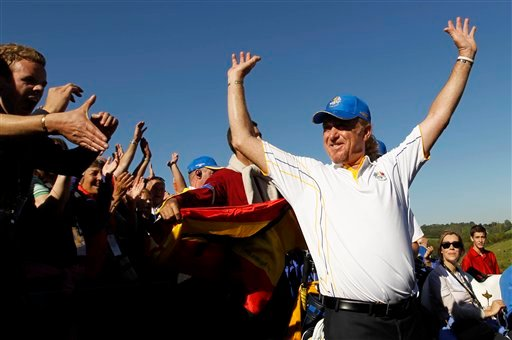 Europe's Miguel Angel Jimenez is congratulated by the crowd after winning his match on the final day of the 2010 Ryder Cup golf tournament at the Celtic Manor Resort in Newport, Wales, Monday, Oct. 4, 2010. (AP Photo/Jon Super)