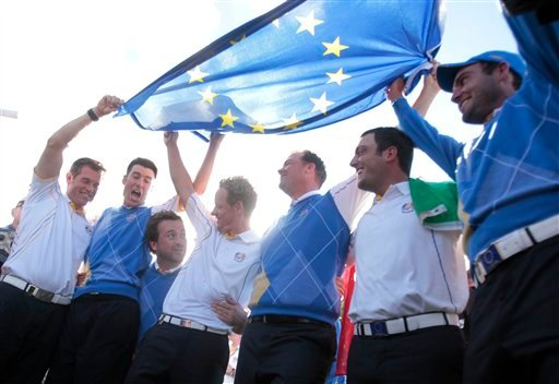 Europe team members from left, Lee Westwood, Ross Fisher, Graeme McDowell, Luke Donald, Peter Hanson, Francesco Molinari and Edoardo Molinari celebrate winning the 2010 Ryder Cup golf tournament at the Celtic Manor Resort in Newport, Wales, Monday, Oct. 4